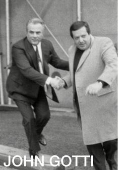 John Gotti and his bodyguard Anthony Mascuzzio. Mascuzzio would be killed in 1988 while shaking down a nightclub owner.