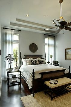 love the light color on teh walls and the ceiling fan/light combo (dark ceiling fan similar to furniture)