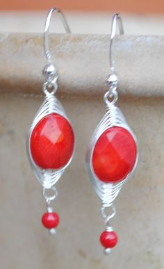 "Beautiful coral earrings in silver.  SO right for summer!  www.annevaughandesigns.com or shop on our Facebook Page at www.facebook.com/annevaughandesigns  Just click on the ""Shop"" icon under our Timeline photo."
