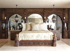 Cher's Hollywood Penthouse – Cher's bed was made from the fragments saved from the palace archways that were used behind the bed to enter into her dressing room. The lanterns were custom made in Marrakesh whilst the bedside cabinets were made from a pair of 19th century Indian doors inlayed with ebony and ivory – © Martyn Lawrence-Bullard Design