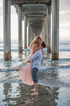San Diego Wedding Photographer: Bianka and Mike shot their engagement session on Windansea Beach and under the Scripps Pier in blue and blush.