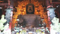 The massive temple building of Todaiji in Nara, houses one of Japan's largest bronze statues of Buddha (Daibutsu). The 15-meters tall, seated Buddha represents Vairocana and is flanked by two Bodhisattvas. This Big Buddha's open hand alone is as tall as a human being.