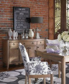 An Aimee Wilder Collection rug in a pop floral pattern lays the foundation for this dining area. @aimeewilder