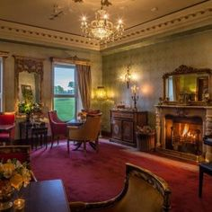 Ffrench Room at Glenlo Abbey Hotel Galway. Welcoming open log fires, afternoon tea served here daily. 5 star luxury hotel set on a 138 acre estate, 2 miles from Galway on the West Coast of Ireland