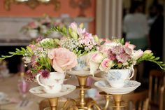 Fabulous large gold teacup candelabra to fill with flowers makes a stunning table centrepiece.  6 available to hire.
