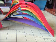 Rainbow Party Craft and set up ideas; cute strip paper rainbow craft or decoration