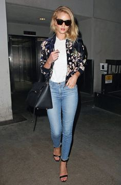 Rosie Huntington-Whiteley in a floral bomber jacket, jeans and heels - click ahead for more travel outfit ideas from models
