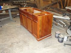 Custom vanity built out of Heart Pine barge board reclaimed from a house built in the 1840's.