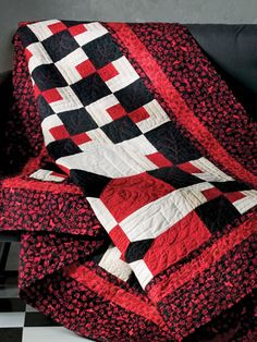 """Different Twist-Combining stretched versions of the Bow Tie and Four-Patch blocks in graphic black, white and red creates a most unusual and pleasing optical illusion. This e-pattern was originally published in Twisted Classics.  Size: 64"""" x 64"""". Block Size: 8"""" x 8"""", 8"""" x 16"""", 16"""" x 16"""". Skill Level: Intermediate Designed by Linda Miller"""