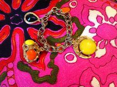 CHANNEY    Vintage yellow and orange charm bracelet  $65