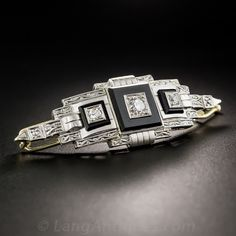 Artfully designed and rendered in platinum over gold during the heart of the Art Deco period - circa 1925-30, in Vienna, Austria!, a chic and striking hair adornment in glorious black & white. The curved, 2 inch long, architectural plaque is inlaid with glossy black onyx squares, each pierced with a sparkling round diamond, all of which are accentuate with fine hand engraved milgraining. Singular and stunning.