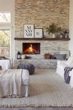 Master bedroom, bedroom, fireplace, bed, cozy, rustic signs, lantern, chair, couch,  baskets, storage,  fireplace in bedroom,  living room,  ottoman, seating,  modern, home decor, living room, family room, rugs, farmhouse, rustic, stone fireplace, Windows, curtains #afflink