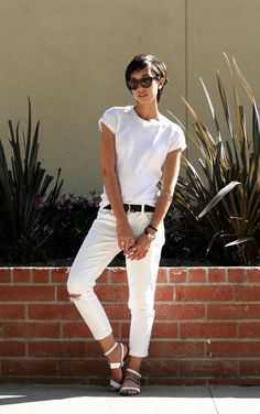 Summer Outfit Idea: White Jeans - distressed white boyfriend jeans worn with a casual white t-shirt, white strappy sandals, + cat-eye sunglasses