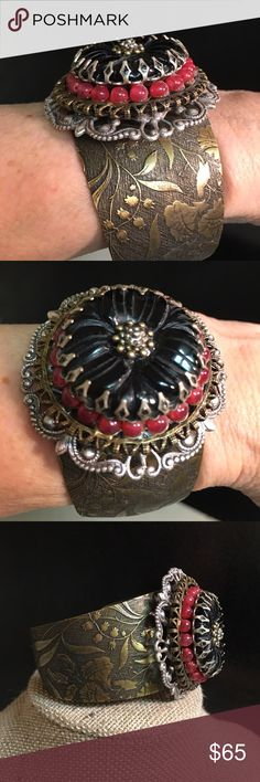 Cuff Bracelet Pictures describe this beauty perfectly. Cuff can be manipulated to fit varying wrist sizes. Never worn. Made in the USA. Ollipop Jewelry Bracelets