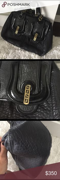 """True authentic Vintage Fendi bag tote This is a stunning true vintage Fendi bag. 100% guaranteed authentic. Any questions you can go ahead and utilize Poshmark concierge service. This Fendi bag is a stunning some white alligator print leather with patent leather as well. Vintage style gold tone. Push up button closure. Stunning logo. Chain and leather strap handles. The bag measures 11x14x4"""" please see additional listings for more photos. Fendi Bags"""