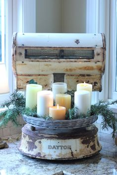 Old scale displaying evergreen sprigs and candles. I'm really starting to like old scales for every season. Noel Christmas, White Christmas, Vintage Christmas, Christmas Vignette, Primitive Christmas, Simple Christmas, Candle Lanterns, Pillar Candles, Candels