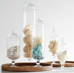 Apothecary Jars for Coastal Decorating with Sea Shells and Seaglass and more... http://www.completely-coastal.com/2017/03/coastal-nautical-jars-canisters.html