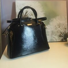 Kate Spade Patent Small Rachelle Beautiful classic patent black Kate Spade bag! Two top handles and an adjustable cross body strap help carry this perfect bag. The leather has a clear lacquer laid over it to protect it from stains and scratches. Perfect size for everyday! kate spade Bags