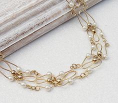 Wire Wrapped White Pearl Gold Necklace by Kikiburrabeads on Etsy, $15.00