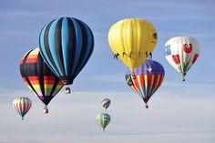 A group of hot-air balloons soars at Albuquerque International Hot Air Balloon Fiesta.