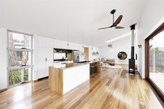 Here is a beach house. There is beautiful flooring and lots of natural lighting. It also has high ceilings like a lot of the houses do in Australia.