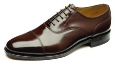 Brown shoes go well with navy suits--always match to your belt.