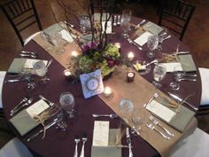 Eggplant tablecloths, sage napkins and a burlap runner.
