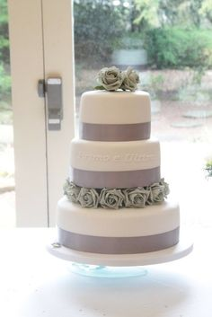 Beautiful stylish simple wedding cake.  Featuring the words primo e ultimo, Italian for first and last :)