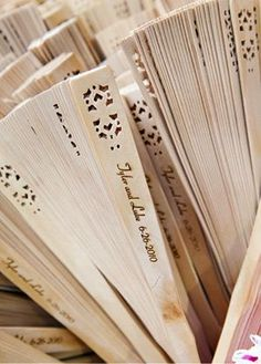 Really wanting these at our wedding (: Ceremony wooden fans. Great for a beach wedding favor!