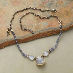 Iolites and blue chalcedony lead to a misty gray moonstone; dangling clusters of pyrite and mixed metals spark the strand. Handcrafted exclusive with sterling silver and 14kt goldplate; lobster clasp