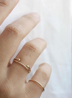 Our double dot cuff ring is the perfect piece for layering and stacking. Made from 14k solid gold, this minimalist ring is the same thickness as our skinny stacker and pairs perfectly together. It's s