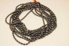 1strand  natural hematite plain rice sized 5 by 8mm by 3yes