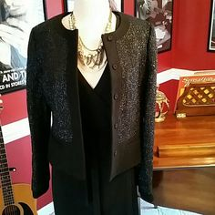 NWT Gorgeous Lined Ann Taylor Jacket/Blazer This is a statement Ann Taylor cropped jacket/blazer  The color is black and shimmery silver.  5 snap button with 2 faux pockets.  Perfect for a night out on the town or a business meeting. Ann Taylor Jackets & Coats Blazers
