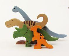 Imagination Kids shop. Cute unique wooden toys. Wooden Dinosaur Toy Set- Waldorf wood dinos. $50.00, via Etsy.