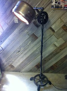 Air compressor pulley base, gas pipe stand with motorcycle sprockets, Antique headlight floor lamp | JAY'S INDUSTRIAL LAMPS