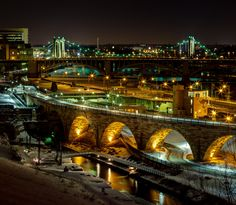 Stone Arch, 3rd Avenue, and Hennepin Avenue Bridges span the Mississippi river