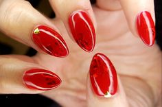 Red gel nail polish with transfer foil and gold detail