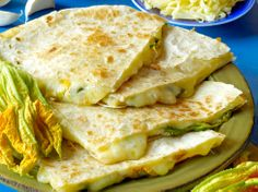 Squash blossom quesadilla. A combination of panela, manchego and cojita is used here, but I love it with really good homemade flour tortillas and queso fresco. Serve with watermelon agua fresca and thank me later.