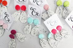 Handmade speckled polymer clay dangle earrings in a range of fun colours! These lightweight beauties are set with aluminium posts with butterfly backings and rubber stoppers. Each piece is hand made, baked and covered in a light gloss. As each item is handmade, shapes and sizes may