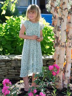 What better season is there than spring? The time when boundless potential ripples through the fabric of life itself! The Primavera dress seeks to mirror this magical, innocent moment in a girl's life with a dress to match. Styled with a flutter sleeve and a double ruffle asymmetrical hemline and made in a lovely cotton crepe, this style will one day bring back some very fond memories.