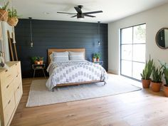 06 - The Pick A Door House A wall of black shiplap took a classic look and made it fit with the feel of the rest of the Wixsom home.A wall of black shiplap took a classic look and made it fit with the feel of the rest of the Wixsom home. Home Bedroom, Bedroom Decor, Master Bedrooms, Navy Master Bedroom, Wall Decor, Dark Gray Bedroom, Black Bedrooms, Rustic Bedrooms, Girls Bedroom