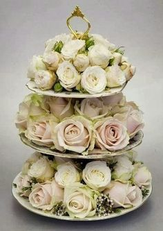 roses on tiered dessert stand