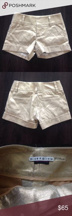 Alice and Olivia gold glitter shorts 0 These are in almost perfect condition. Gold glittery shorts. Size 0 made in New York City. Alice + Olivia Shorts