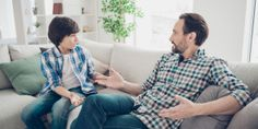 Portrait of two nice attractive friendly guys dad and pre-teen son sitting on couch discussing psychology generation problems in light white modern style interior living-room Donate Now, Couture, Model Release, Our Kids, Living Room Interior, Current Events, Blouse, Photo Editing, Dads