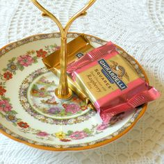 $35 on Etsy. High Tea Vintage China Saucer Stand (prop business cards, party place setting cards, candy, jewelry, soap dish, etc.)