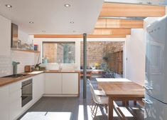 "North London house extension by Denizen Works transforms a ""small dark bachelor pad"" into a family home with a light-filled kitchen and dining space New Kitchen, Kitchen Dining, Kitchen Decor, Small Kitchen Diner, Kitchen Ideas, Family Kitchen, Kitchen Cabinets, Küchen Design, House Design"