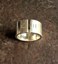 An amazing bold silver ring with initials. A perfect gift for a lover or for a couples. This ring has a strong modern look for those who loves statement