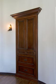 Extra doorway, turned into a shallow cabinet.