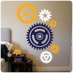 """This set of multi-colored gears and cogs features three sheets of a different color. The dimensions of each gear are labeled in the second image on the listing. This design features three colors.Click """"ADD TO CART"""" to make your custom color selections."""