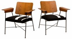 Pair of Rare Robin Day Lounge Chairs, England c. 1950 Two Robin Day lounge chairs in bent plywood with metal frame, a rare find in such excellent condition. Newly reupholstered in stunning Gabrial Savak wool & cotton fabric, these chairs represent truly top-drawer examples of mid-century design and construction.
